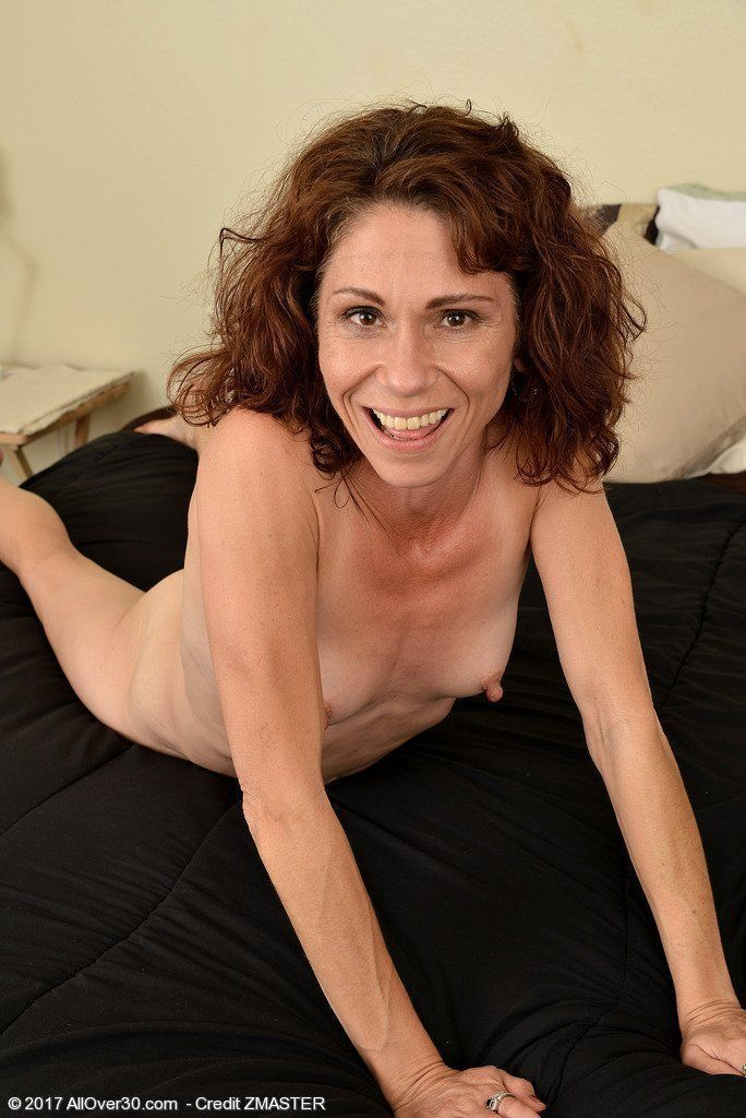 Mature with curly brown hair naked
