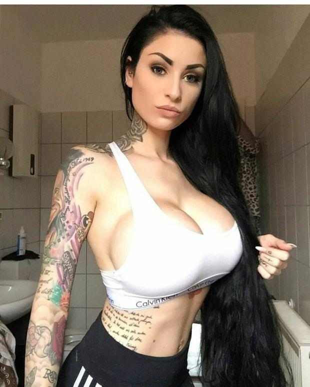 Tattooed busty girl