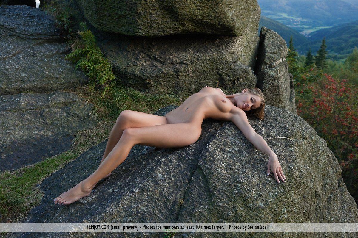 Nude women rock climbing